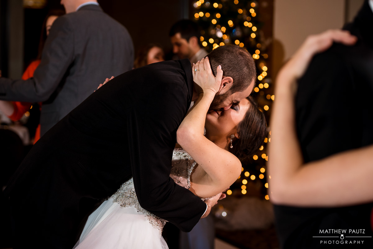 Commerce Club reception photos | bride and groom kissing