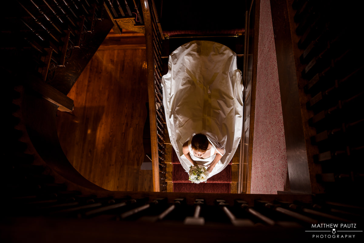 Bride walking down stairs at The Poinsett Club