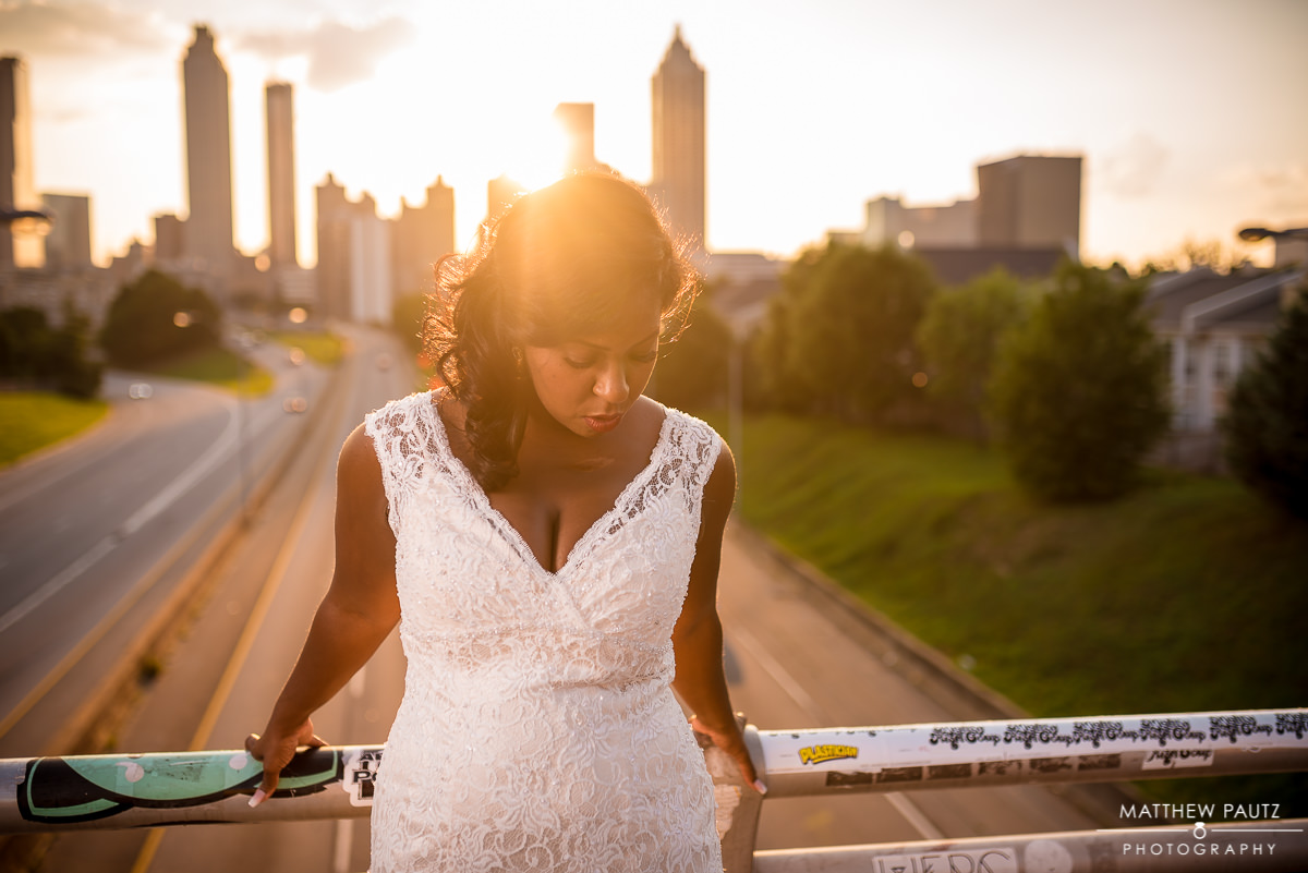 Bride at sunset overlook downtown Atlanta Georgia skyline