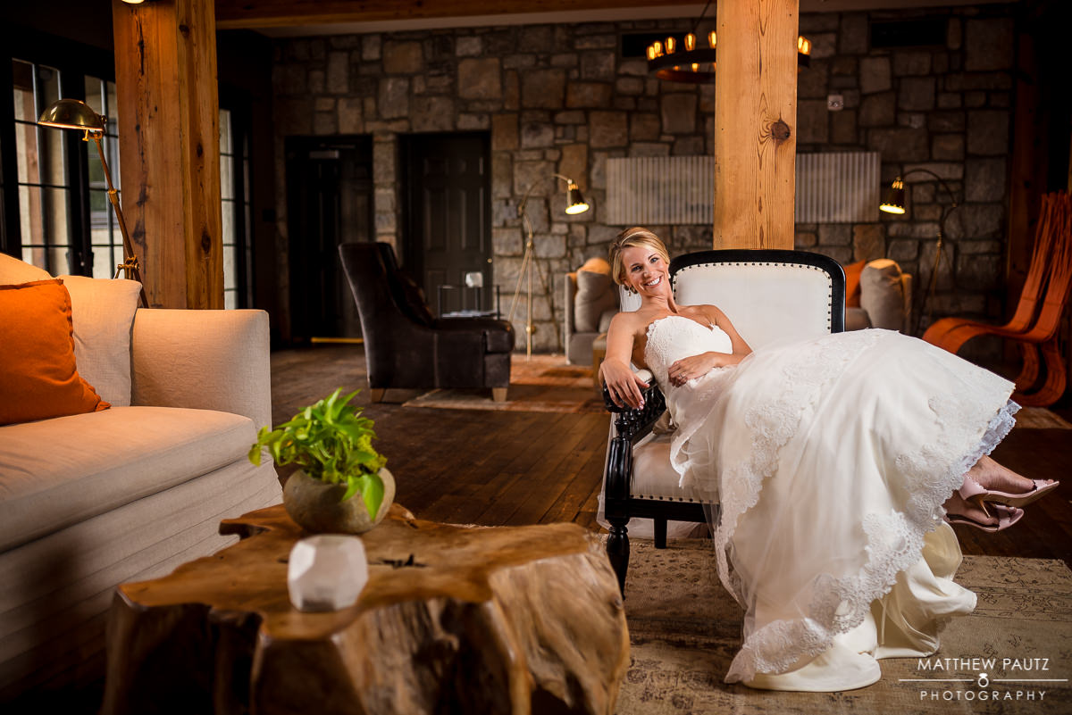 bride in wedding dress smiling in a chair inside Hotel Domestique