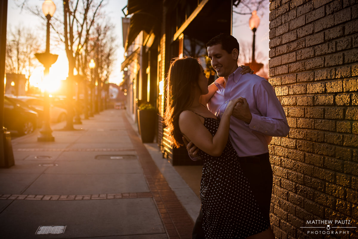 couple dancing on main street at sunset in Greenville