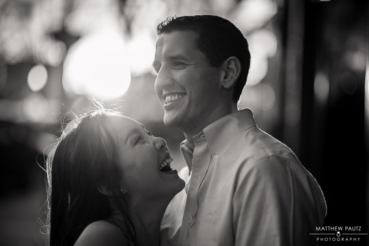 engaged couple laughing and having fun during their greenville engagement photos