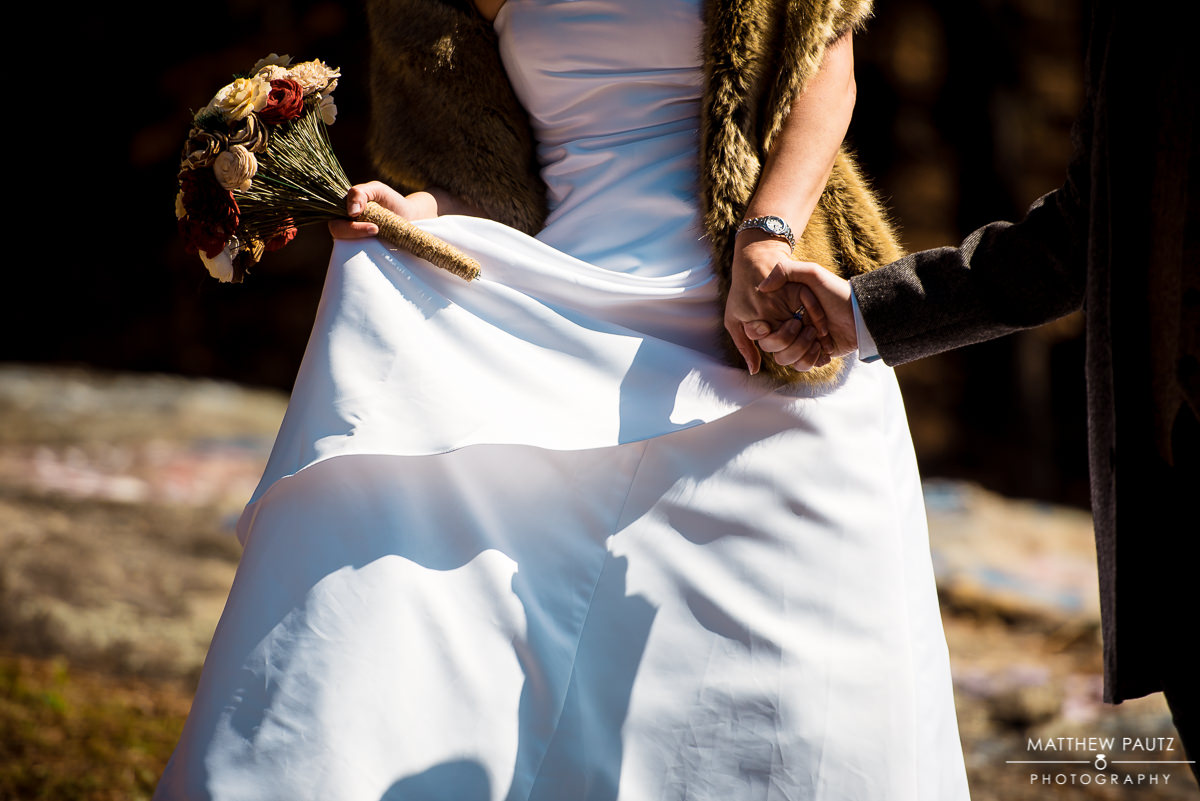 bride walking hand in hand with groom at caesars head