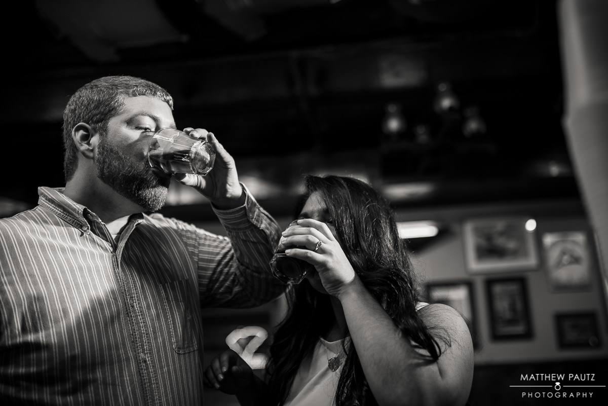 engaged couple taking shots in a bar in clemson sc