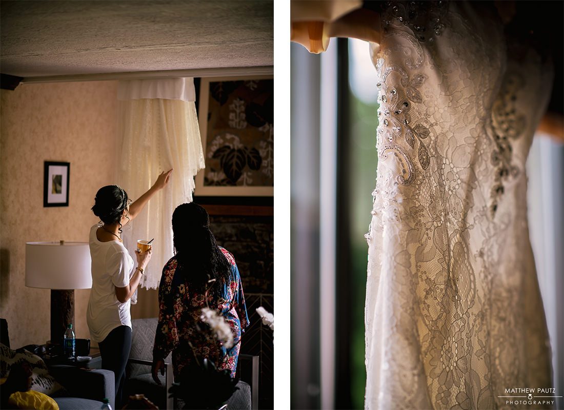 Bride looking at wedding dress in morning before wedding day