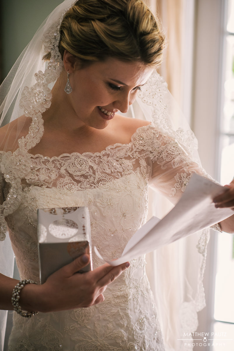 bride opening gift on day of wedding