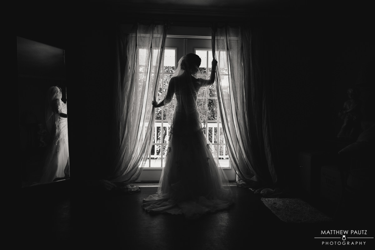 Bride posing in front of window at Twigs Tempietto in Greenville SC