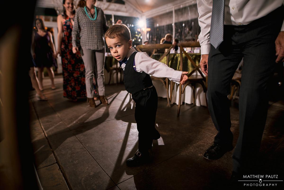 Ring bearer dancing at wedding reception