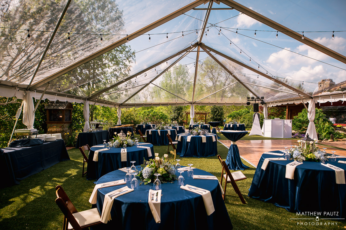 Clear tent wedding reception setup