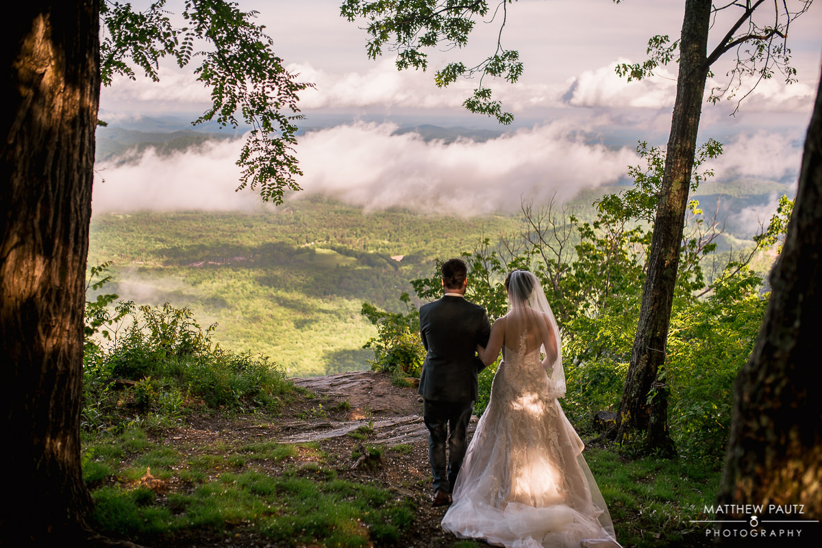 Bride and groom walking to beautiful mountain view