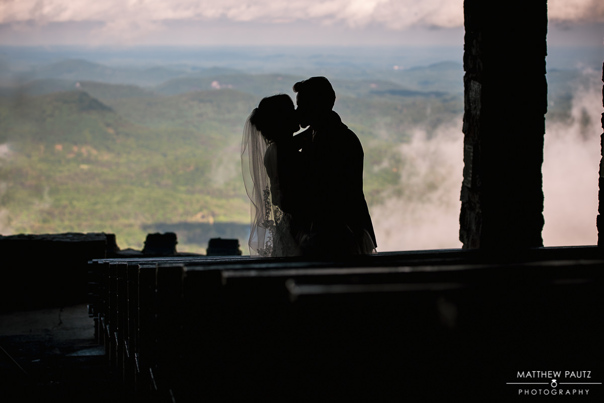 silhouette of Bride and groom kissing after wedding
