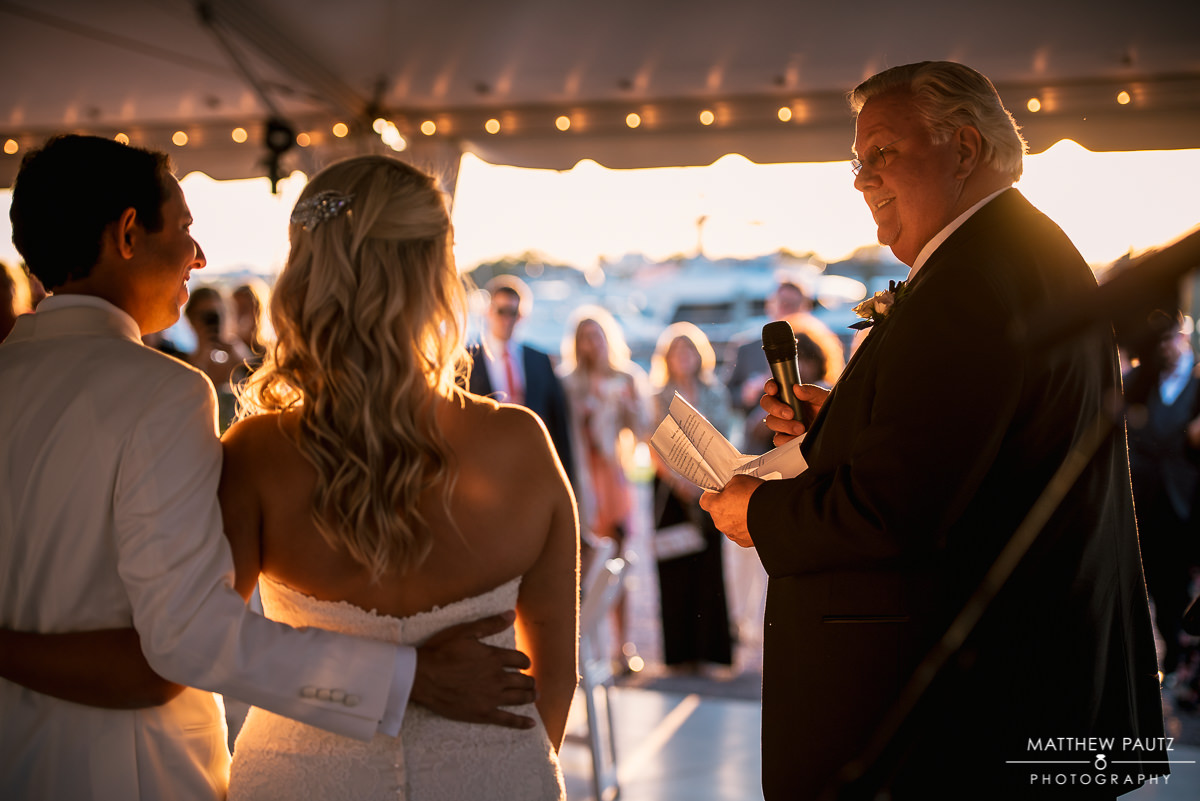 father of bride giving wedding toast at reception