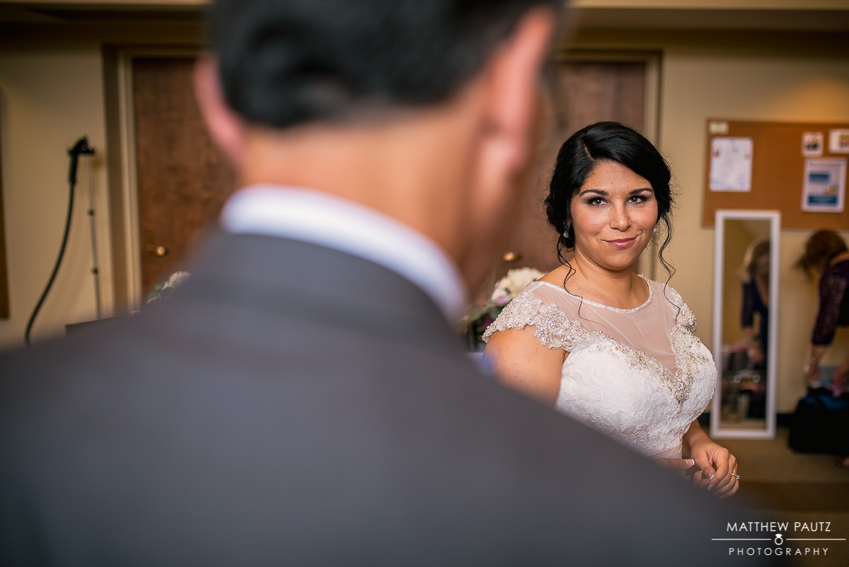 bride looking at father before ceremony