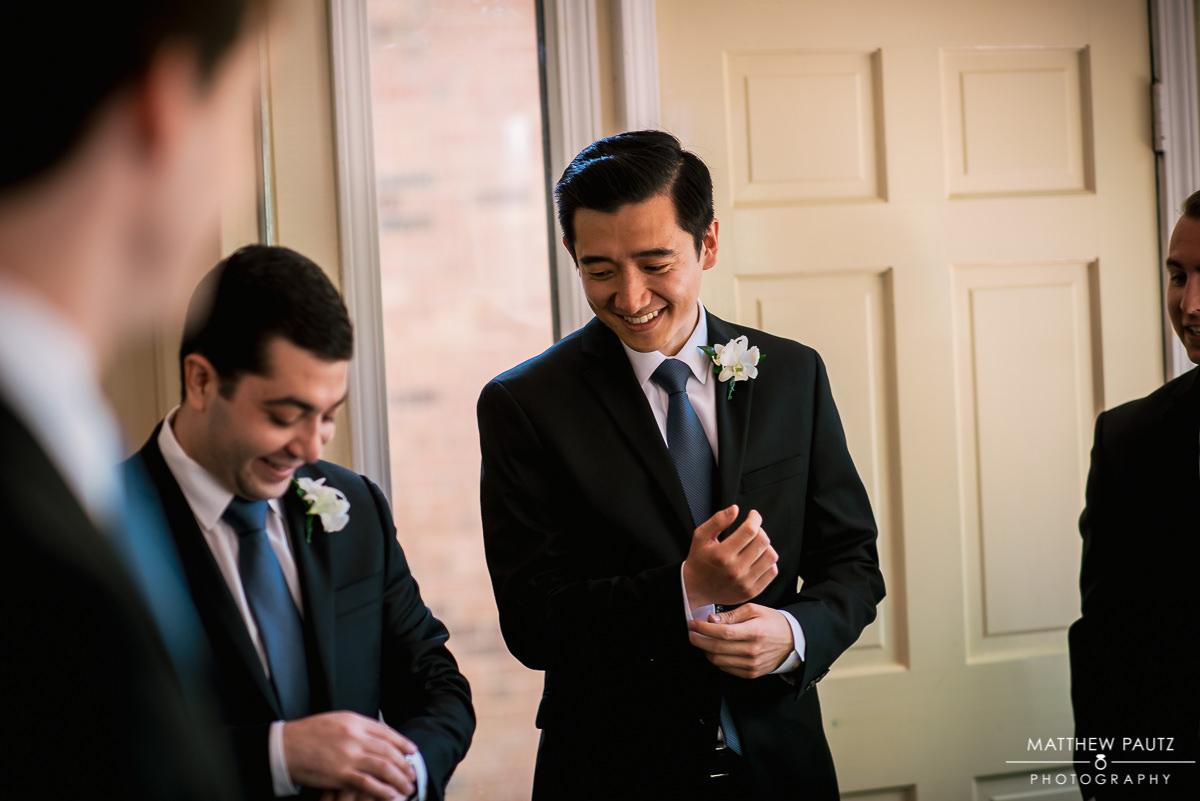 Groomsmen getting ready at catholic church before wedding
