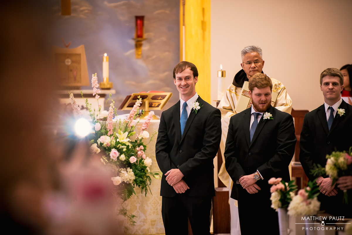Groom sees bride for first time at wedding ceremony