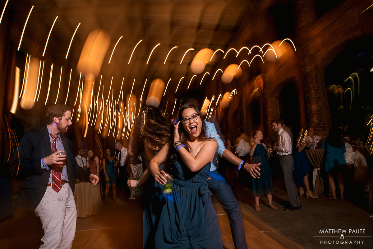 bridesmaid dancing at wyche pavilion reception at night
